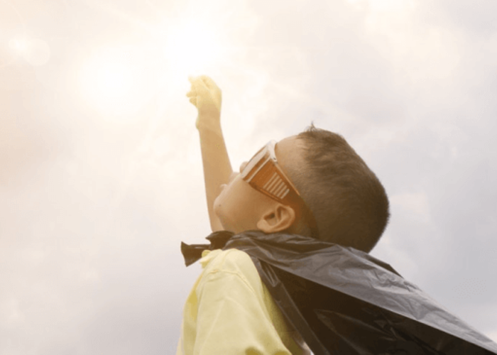 A Boy looking up to the sky